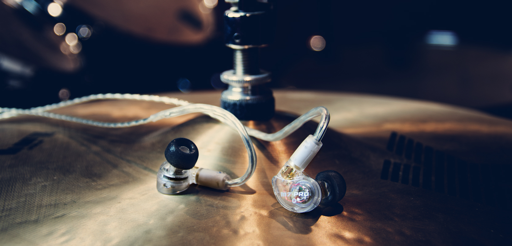 M7 PRO IEMs on a set of drums and cymbals